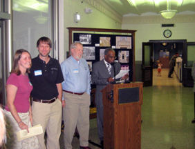 County Judge Samuel T. Biscoe, with members of the Page family, welcomes guests to the first annual Travis County History Day.